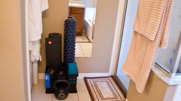 A crate of workout tools in the bathroom helped Dana Santas stay accountable.