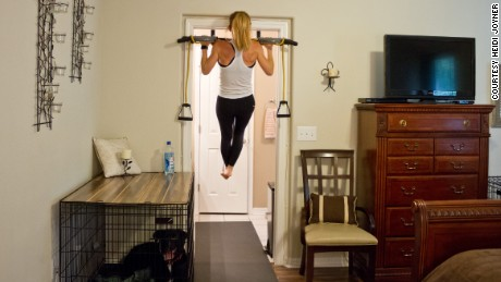 A pull-up bar in the doorway helped her meet her goal.