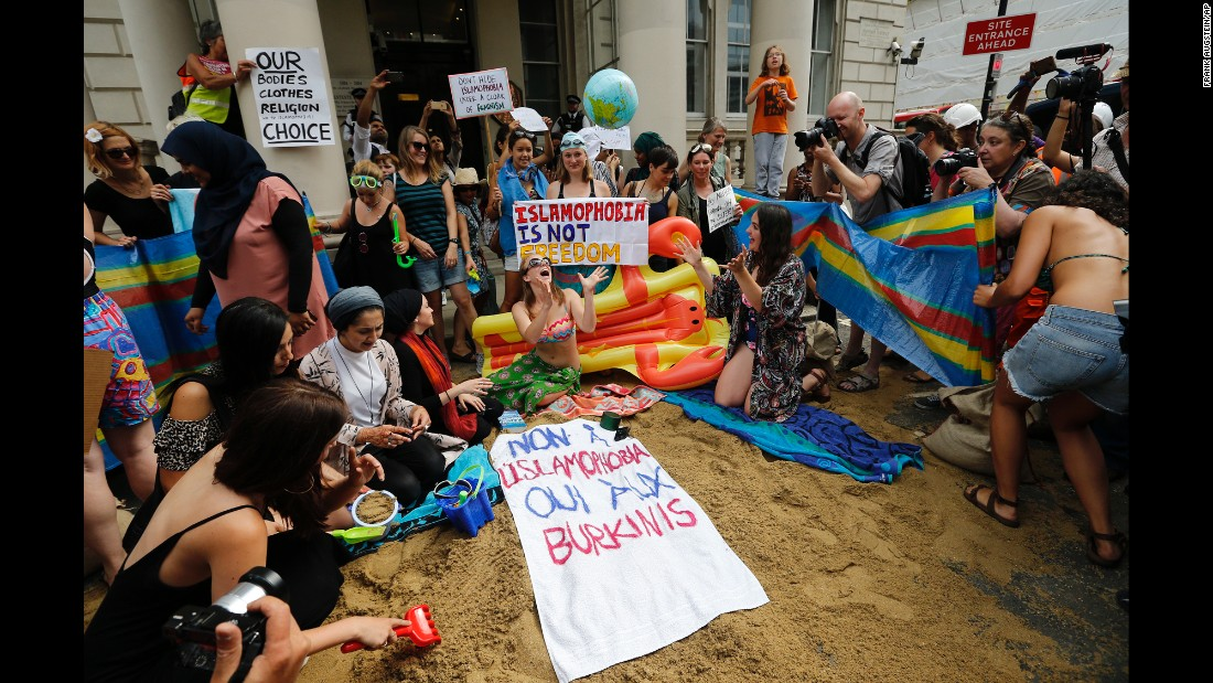 "People protest outside the French Embassy in London on Thursday, August 25, in response to some French authorities' decision to <a href=""http://www.cnn.com/2016/08/24/europe/woman-burkini-nice-beach-incident-trnd/"" target=""_blank"">ban women from wearing burkinis on the beach</a>. The French Council of State <a href=""http://edition.cnn.com/2016/08/26/europe/france-burkini-ban-court-ruling/index.html"" target=""_blank"">suspended the ban</a> on Friday, August 26, ruling that French mayors do not have the right to ban burkinis -- swimsuits that cover the whole body except for the face, hands and feet."