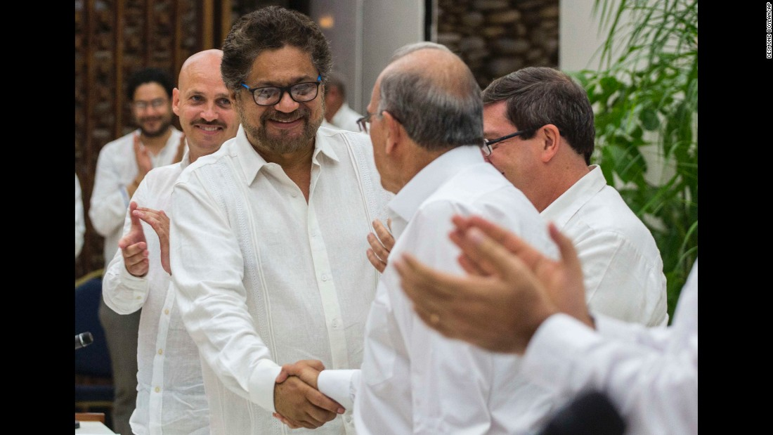 "Ivan Marquez, left, shakes hands with Humberto de la Calle in Havana, Cuba, on Wednesday, August 24. Marquez, the commander of the Marxist rebel group FARC, and de la Calle, Colombia's chief negotiator, were together after <a href=""http://www.cnn.com/2016/08/25/americas/colombia-farc-peace-deal-explainer/"" target=""_blank"">reaching a final peace deal</a> in one of the world's longest-running conflicts."