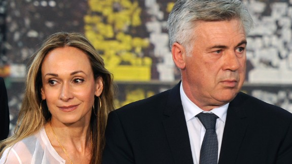 New Real Madrid's Italian coach Carlo Ancelotti (R) and his wife Mariann Barrena pose during his presentation at Santiago Bernabeu stadium, in Madrid on June 26, 2013. Ancelotti said he is delighted to have finally arrived to start his new role in the Spanish capital and announced that French former football player Zinedine Zidane will be one of his assistants.  AFP PHOTO/ DOMINIQUE FAGET        (Photo credit should read DOMINIQUE FAGET/AFP/Getty Images)