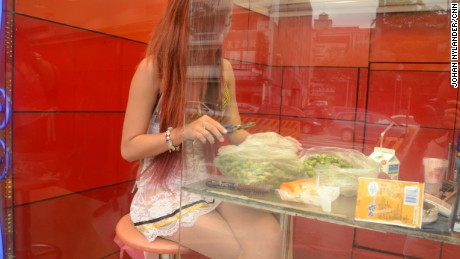 Ling Ling prepares betel nuts behind a full-height transparent window in Taipei.