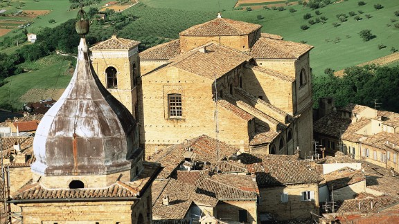 In a photo taken  before the earthquake, the Church of San Giuliano is seen behind the bell tower of the Church of St. Paul in Macerata.
