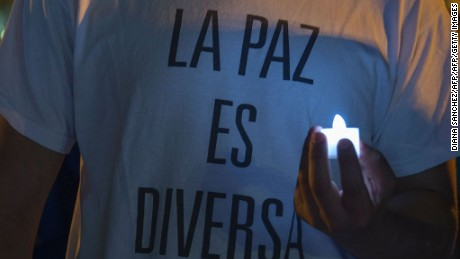 "A man wearing a t-shirt reading ""peace is diverse"" takes part in a protest against homophobia in Bogota, Colombia, on August 16, 2016. / AFP / Diana SANCHEZ        (Photo credit should read DIANA SANCHEZ/AFP/Getty Images)"