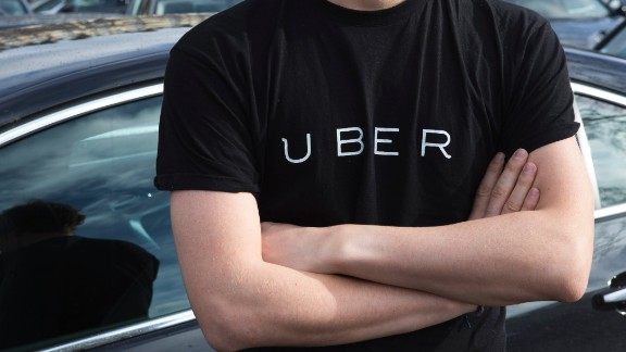 "A protester wears a shirt displaying the logo of smartphone ride service Uber during by a protest by non-licensed private hire drivers blocking the Place de la Nation in Paris on February 9, 2016. Members of services known in France as ""voitures de tourisme avec chauffeur"" (VTC - Tourism vehicle with driver) have been protesting against assurances the French Prime minister has given to taxis.  / AFP / Geoffroy Van der Hasselt        (Photo credit should read GEOFFROY VAN DER HASSELT/AFP/Getty Images)"