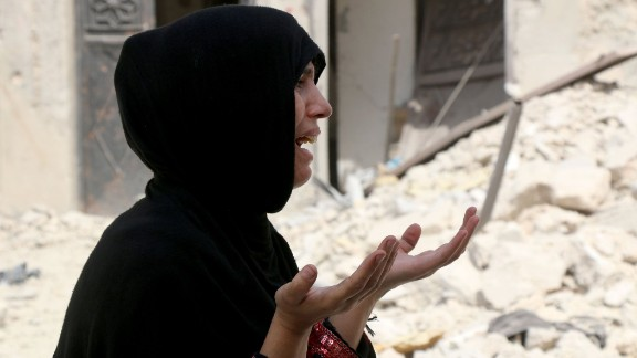 A Syrian woman despairs after a barrel bomb attack in Aleppo on August 25.