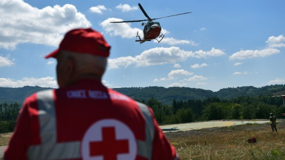 An emergency services helicopter takes off in Amatrice as rescuers continue the search for survivors.