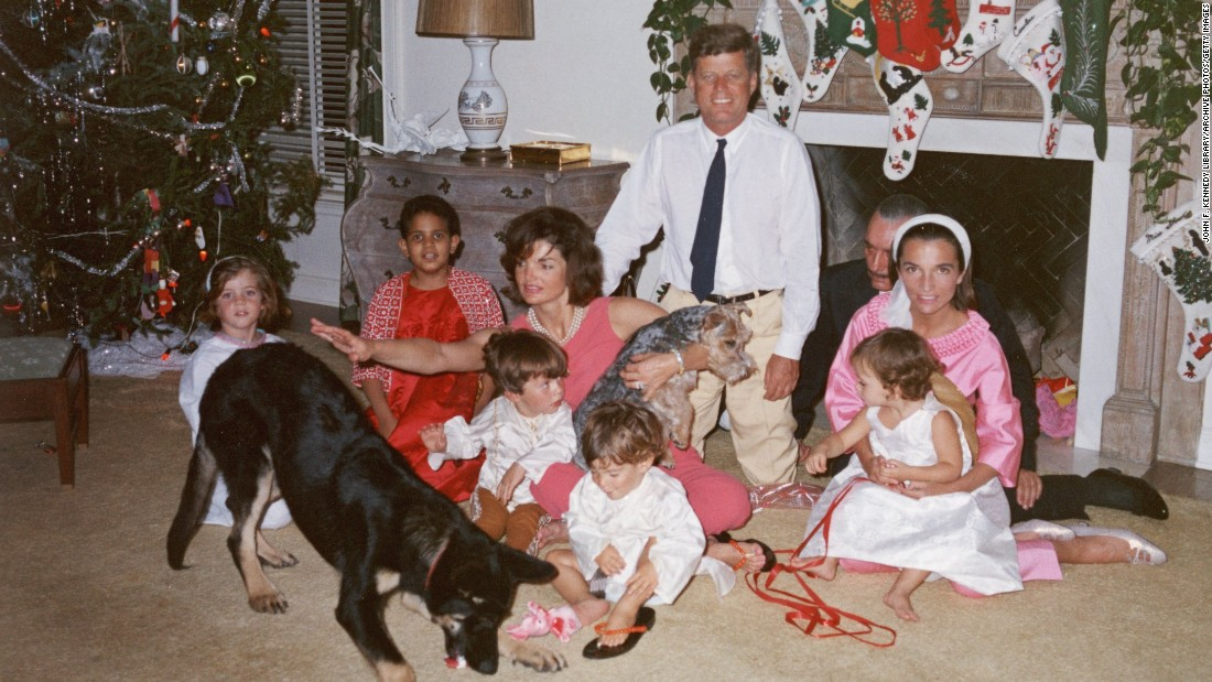 President John F. Kennedy and first lady Jacqueline Kennedy pose with their family and their dogs, German shepherd Clipper and Welsh terrier Charlie, on Christmas Day at the White House in 1962.