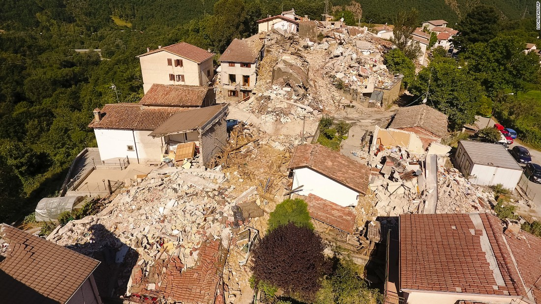 An aerial view shows the damage in the village of Saletta on August 26. Strong aftershocks in the region have rattled residents and emergency crews.