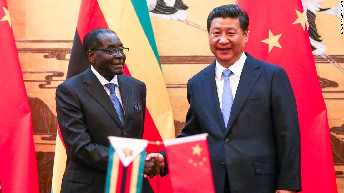 Mugabe and Chinese President Xi Jinping participate in a signing ceremony in Beijing in 2014.