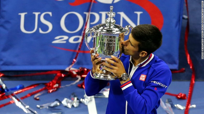 NEW YORK, NY - SEPTEMBER 13:  Novak Djokovic of Serbia celebrates with the winner's trophy after defeating Roger Federer of Switzerland during their Men's Singles Final match on Day Fourteen of the 2015 US Open at the USTA Billie Jean King National Tennis Center on September 13, 2015 in the Flushing neighborhood of the Queens borough of New York City. Djokovic defeated Federer 6-4, 5-7, 6-4, 6-4.  (Photo by Maddie Meyer/Getty Images)