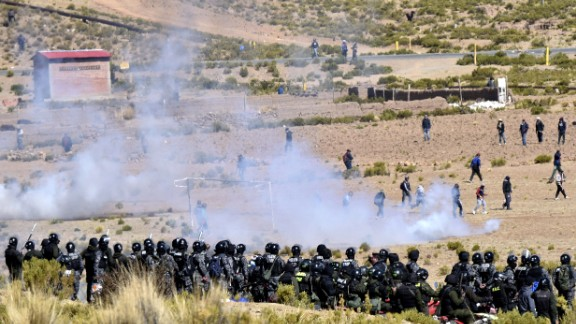 Riot policemen and miners clash in Panduro, Bolivia.