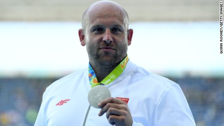 Silver medalist Piotr Malachowski decided to auction off his medal after learning about a little boy's battle with eye cancer.