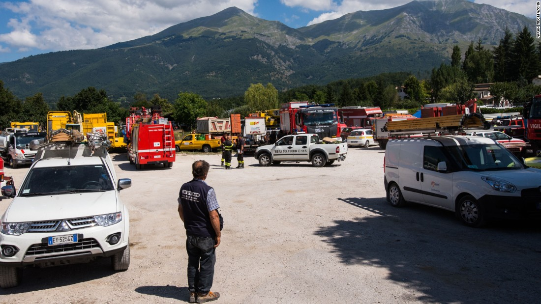 Three days on, various emergency response groups congregate in an open area in Amatrice. Rescuers were initially hindered by the lack of access to the mountain town.