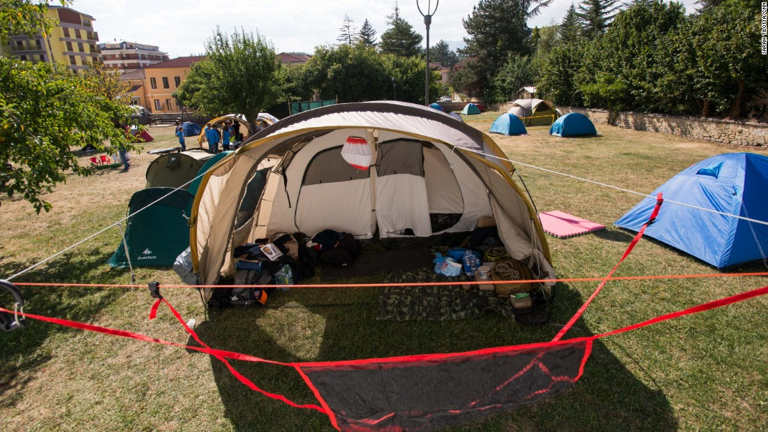 An camp for emergency volunteers is erected in a park in Amatrice.