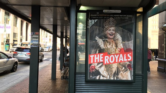 """A poster of """"The Royals"""" television series, starring Clinton, hangs on a bus stop in Los Angeles."""