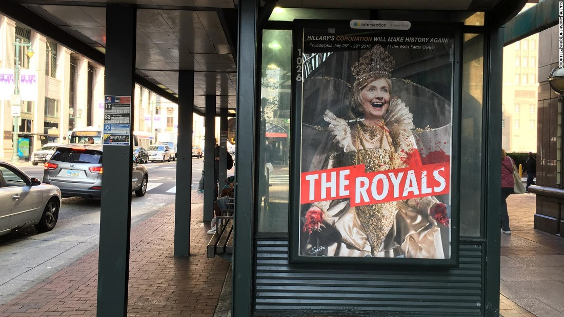 "A poster of ""The Royals"" television series, starring Clinton, hangs on a bus stop in Los Angeles."
