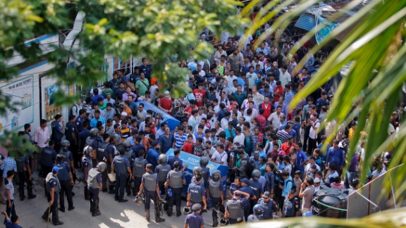 A crowd gathered near the scene of the raid. Police staged an hour-long gun battle before shooting dead three suspected militants.