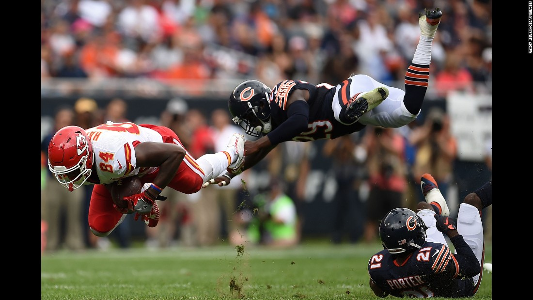 Kansas City's Demetrius Harris is tripped up by Harold Jones-Quartey during an NFL preseason game in Chicago on Saturday, August 27.