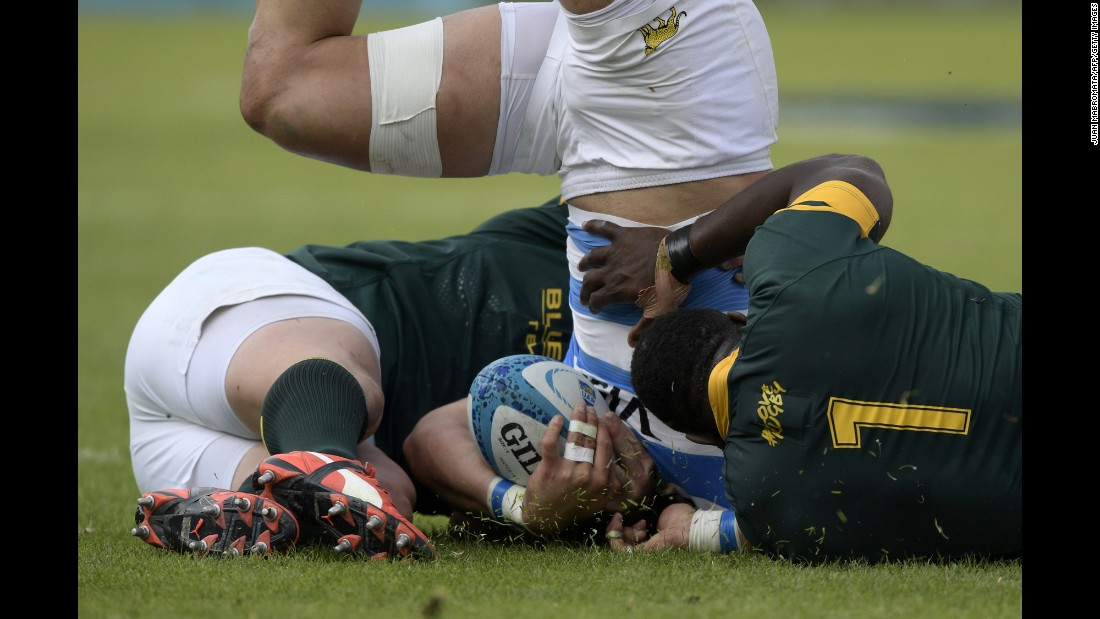 Argentina's Facundo Isa is tackled by two South African players during a Rugby Championship match in Salta, Argentina, on Saturday, August 27. Argentina won 26-24.