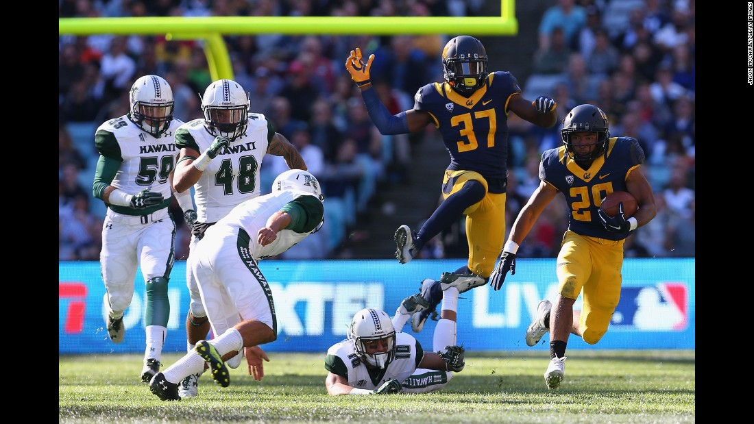 California's Khalfani Muhammad runs the ball against Hawaii during the college football opener, which took place in Sydney -- yes, Australia -- on Saturday, August 27. California won 51-31.
