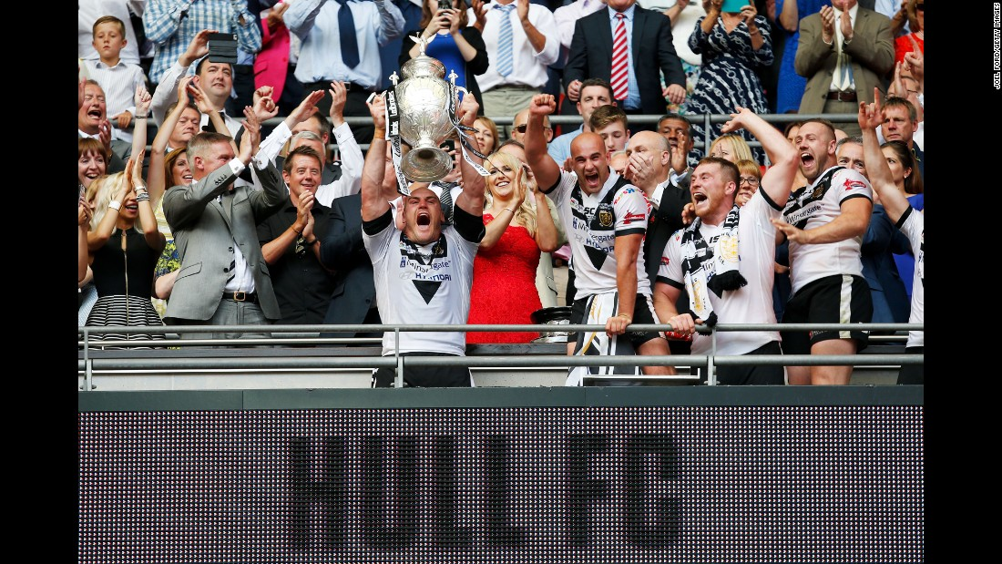 Gareth Ellis, captain of English rugby club Hull, holds up the Challenge Cup after Hull defeated Warrington in the final on Saturday, August 27.