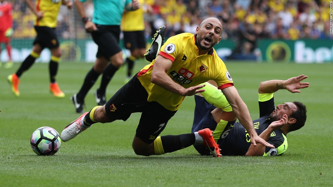 Watford's Nordin Amrabat, left, is tackled by Arsenal's Granit Xhaka during a Premier League match in Watford, England, on Saturday, August 27.