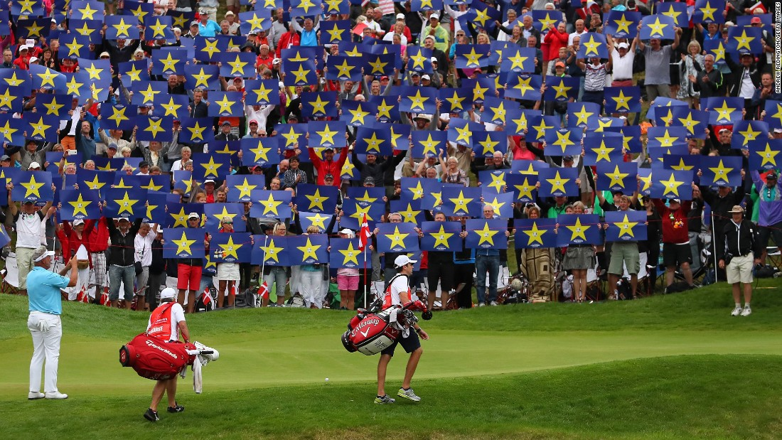 "Members of the crowd hold up ""Go Europe"" placards as Darren Clarke, captain of Europe's Ryder Cup team, takes video of them during a tournament in Aalborg, Denmark, on Friday, August 26. The Ryder Cup begins September 27 in Minnesota."