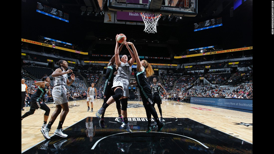 San Antonio's Jayne Appel-Marinelli drives to the hoop during a WNBA game against New York on Friday, August 26.