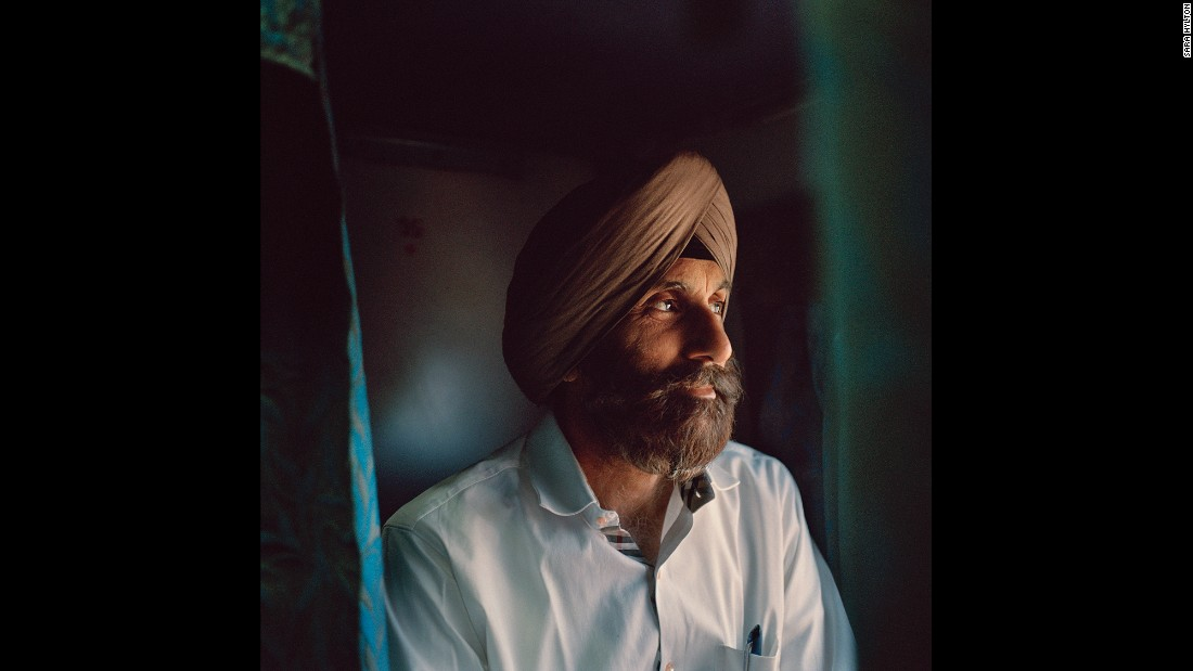 PP Singh looks out the window on the Kochuveli Express. Unlike many other Indians, Singh and his family had the luxury of traveling in second AC, which offers bedding, air conditioning and more space and privacy.