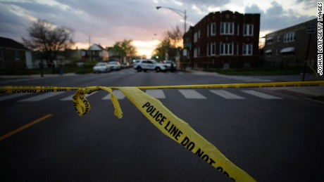 CHICAGO, IL - APRIL 25: Chicago Police crime tape is displayed at the scene where a 16-year-old boy was shot in the head and killed and another 18-year-old man was shot and wounded on the 7300 block of South Sangamon Street on April 25, 2016 in Chicago, Illinois. Last week Chicago reached over 1,000 people shot since the beginning of the year. (Photo by Joshua Lott/Getty Images)