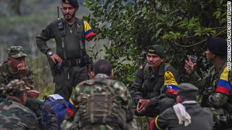 Revolutionary Armed Forces of Colombia (FARC) member Enrique (2-L), who lost an arm eight years ago, is seen at a camp in the Magdalena Medio region, Antioquia department, Colombia on February 18, 2016. FARC leader Timoleon Jimenez confirmed that his men were attacked by the Colombian army as they went to received one of the commanders who takes part in the Havana peace talks, who was going to inform them about the situation of the negotiations. The Marxist guerrillas have been observing a unilateral ceasefire since July. But while the government has stopped bombing FARC positions, it has yet to accede to the rebels' demand for a bilateral ceasefire. AFP PHOTO / LUIS ACOSTA / AFP / LUIS ACOSTA        (Photo credit should read LUIS ACOSTA/AFP/Getty Images)