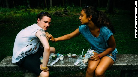 Kyle shows Anaële the tattoo he designed in memory of his father, who died on 9/11.