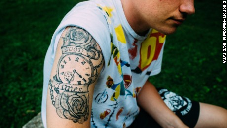 Kyle designed a tattoo with a rose that symbolizes love and hurt and a clock tepresenting the time he had with his father.