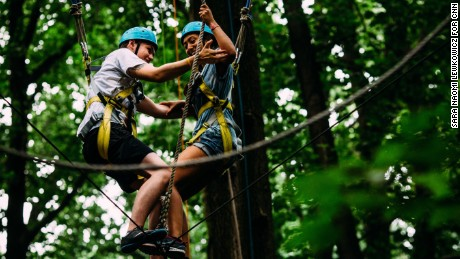 Kyle and Anaële help each other through an exercise deigned to build trust and overcome fears.