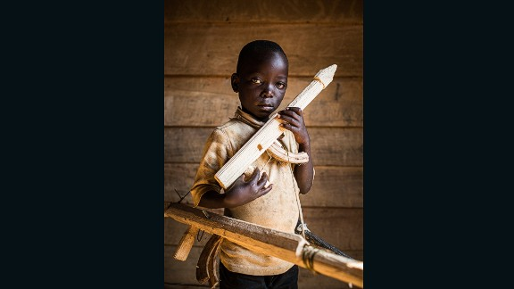 """Paradoxe (Soldier), Democratic Republic of the Congo . """"I don't know my exact age, and I don't go to school. One day I will be a soldier, to fight other soldiers. Soldiers are not kind because they killed my brother""""."""