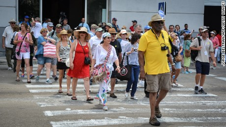 Passengers of the first US-to-Cuba cruise ship to arrive in the island nation in decades, walk in the streets of Havana right after disembarking on May 2, 2016.