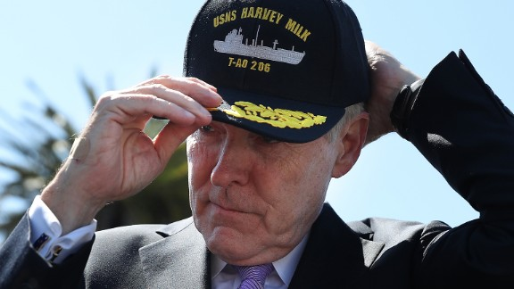 Former Navy Secretary Ray Mabus puts on a hat for the new USNS Harvey Milk during a  ceremony on August 16, 2016.