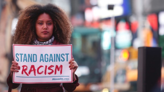 """NEW YORK, NY - MARCH 16:  Members of MoveOn.org Political Action stand outside the studios of """"Good Morning America"""" to broadcast messages of love, dignity, and equality and stand up against the hate, racism, and incitement of violence that the group says has become a hallmark of Donald Trump's presidential campaign in New York City on Wednesday, March 16, 2016 in New York City."""