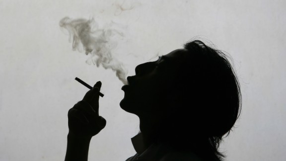 NANJING, CHINA - MAY 31: (CHINA OUT) In this photo illustration a man exhales smoke whilst smokign a cigarette on World No Tobacco Day, May 31, 2007 in Nanjing, China. About 540 million Chinese are suffering the effects of passive smoking and more than 100,000 of them die annually from diseases caused by passive smoking, according to the Ministry of Health. China is the world's largest tobacco producing and consuming country, accounting for more than a third of the global total on both counts. It is estimated that China has more than 350 million smokers and nearly one million die from smoking-related diseases each year. (Photo by China Photos/Getty Images)