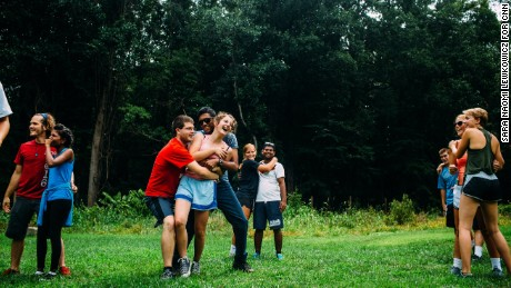 Campers and counselors play the Person-to-Person trust-building exercise at Outward Bound.