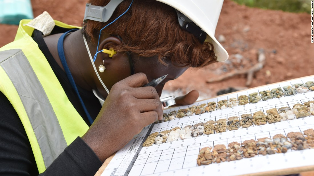 Employee inspects mineral samples at the Agbaou gold mine.