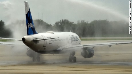 A JetBlue plane departs for Cuba amidst water canons on August 31, 2016 at Fort Lauderdale National Airport in Fort Lauderdale, Florida.  Cuba and the United States open their newest chapter in relations on Wednesday with the first regular commercial flight from America to the communist-ruled island in more than 50 years. JetBlue Flight 386 is set to take off from Fort Lauderdale in southeastern Florida at 9:45 am (1345 GMT) with 150 passengers on board. After an hour-long flight, it will land in central Cuba's Santa Clara, 175 miles (280 kilometers) east of Havana.  / AFP PHOTO / RHONA WISERHONA WISE/AFP/Getty Images