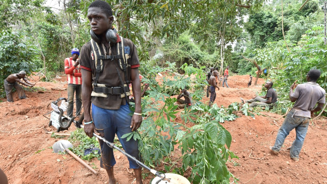A man holds a metal detector as gold diggers work in the forest of Bore village near Dimbokro, central Ivory Coast.<br /><br />The government is keen to develop new sites, but has been forced to contend with a shadow industry of illegal mines.