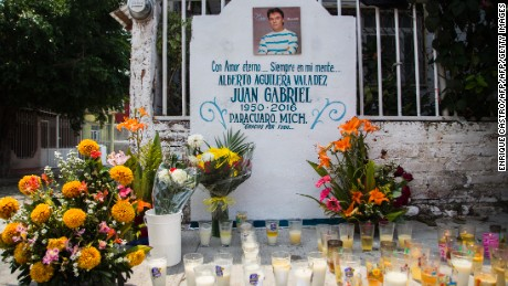 "Candles and flowers are seen in an altar erected in front of the house where Mexican composer and singer Alberto Aguilera, known as ""Juan Gabriel"" was born in Paracuaro, Michoacan state, Mexico on August 29, 2016.  Mexico and the music world on Monday mourned the death of legendary singer Juan Gabriel, who touched millions with wrenching ballads of love and loneliness as he rose from the rough streets of Ciudad Juarez to a world stage. / AFP / ENRIQUE CASTRO        (Photo credit should read ENRIQUE CASTRO/AFP/Getty Images)"