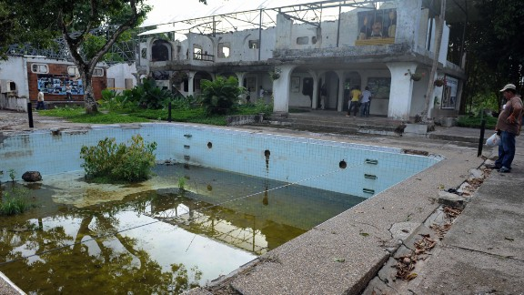 Visitors in 2009 examine what was left of Escobar's mansion, including the swimming pool. The mansion has since been demolished.