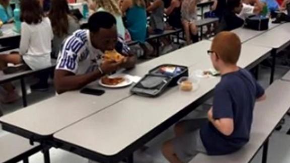 fsu football player sits lunch pkg_00011219.jpg