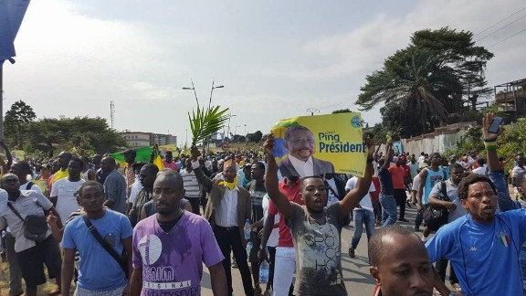 Supporters of Gabonese opposition leader Jean Ping face off with police in Libreville on Wednesday.
