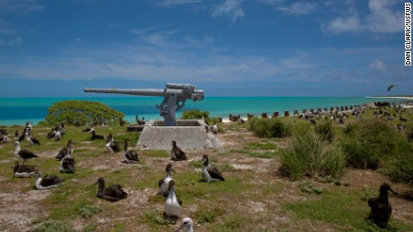 Obama highlights climate agenda on tiny Midway island