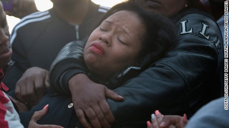 Tambrasha Hudson is comforted as she joins demonstrators protesting the shooting death of her son 16-year-old Pierre Loury on April 12, 2016 in Chicago.